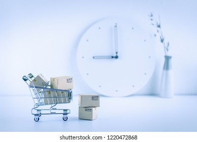 Shop online, ecommerce / retail commerce concept : Box or cartons in a trolley or shopping cart on a seller working desk / office table, depicts new lifestyle customers buy products via online store.