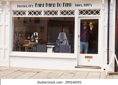 Shop owner opening up record, CD and hi-fi shop
