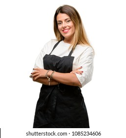 Shop owner woman wearing apron with crossed arms confident and happy with a big natural smile laughing