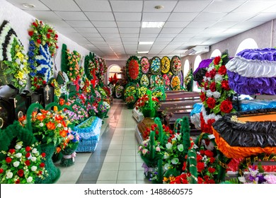 Shop selling coffins, funeral wreaths and flowers. Sale of funeral accessories