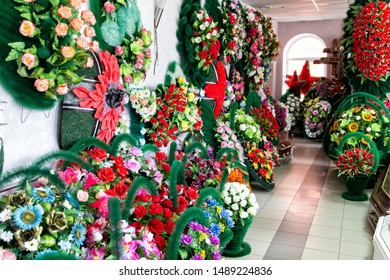 Shop selling coffins and funeral wreaths. Sale of funeral accessories