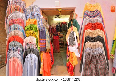 A shop selling colorful clothing items.