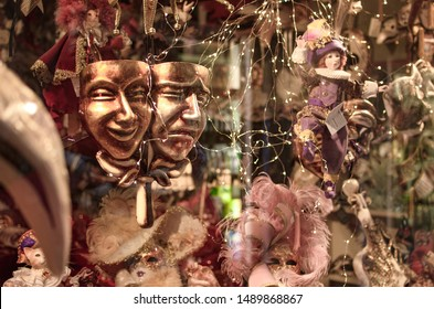 Shop with souvenirs in Venice Carnival masks and dolls behind the window