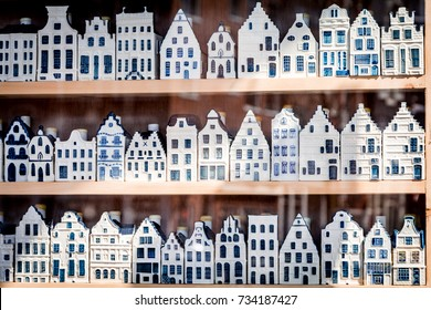 Shop window with 3 rows of Delftware porcelain Dutch style houses