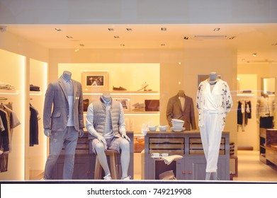 shop window with clothes, street view through glass.