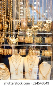 The shop window of a jeweller's in wealthy Doha, Qatar, showing the traditional gold and gem work of Arabia and the East