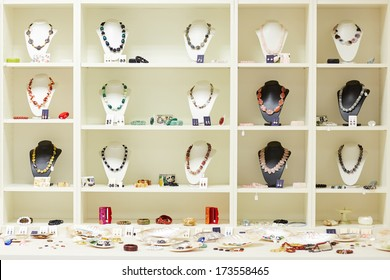 Shop window with necklaces and jewelry on display at jeweler