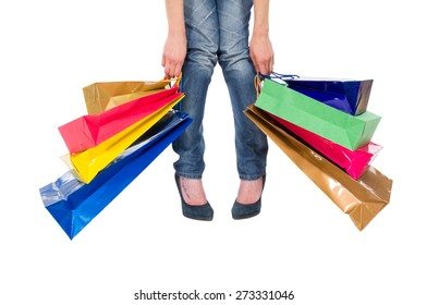 Shopaholic concept with heavy shopping bags and woman legs