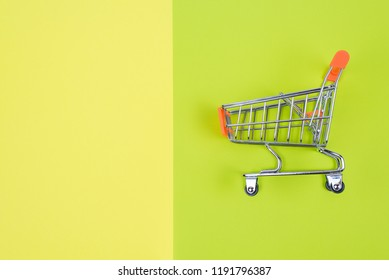 Shopaholic shopper memo text concept. Close up top above overhead high angle close up view photo of one single shine  pushcart isolated divided juicy saturated green yellow color background copy space