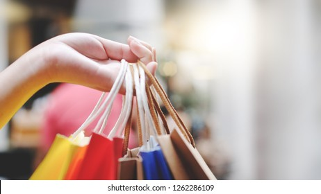 Shopaholic woman with shopping bags, buying a lot of fashion clothes