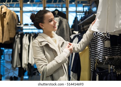 Shopaholic woman shopping clothes on sale