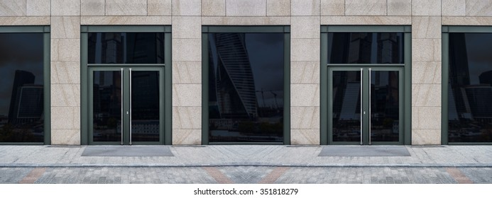 Shopfront with large windows. Showcase with Place for Name