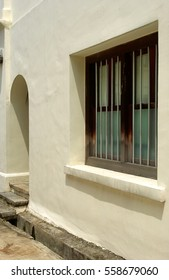 Shophouses along streets of South East Asia city Singapore textured walls natural sunlight artistic angles