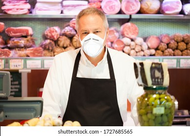 Shopkeeper smiling in a grocery store