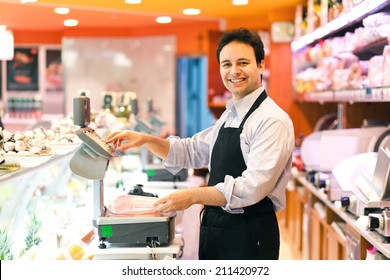 Shopkeeper working in his grocery store