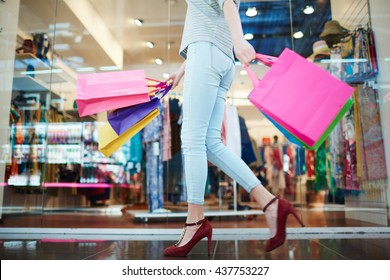 Shopper in casual-wear walking in trade center
