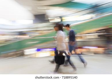 Shopper walking in front of shop window