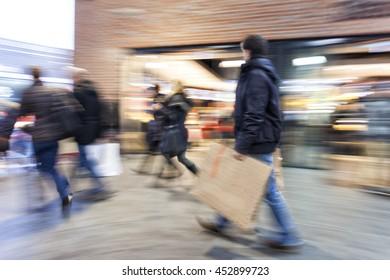 A shopper walking past a store window