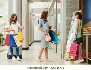 Shoppers looking in mirror