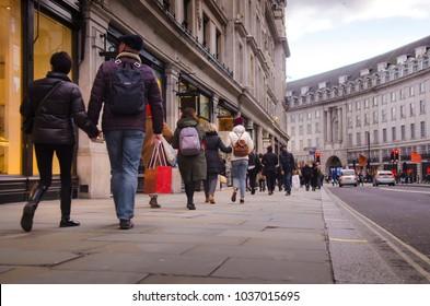 Shoppers walking on Regent Street, a famous shopping street in London