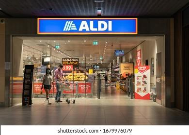 Shoppers wearing face mask at entrance of Aldi supermarket. Coronavirus outbreak in Melbourne, Australia - 17 Mar, 2020