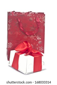 Shopping bag with colorful box on white