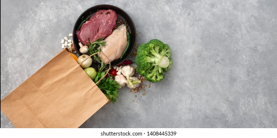 Shopping bag groceries with healthy food top view on a concrete background copy space
