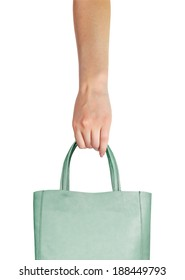 Shopping bag in hand. Consumerism symbol