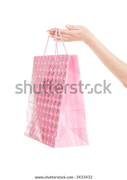 Shopping bag in hand isolated on white background
