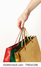 shopping bags in hands on white background,color gift bag