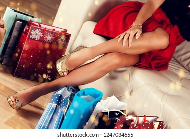 Shopping bags near sexy woman legs. Holidays and celebration concept