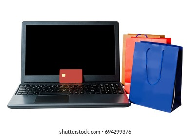 Shopping bags and open laptop isolated  on white background. On line shopping concept