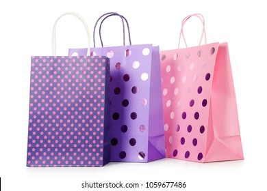 shopping bags with polka dots isolated on white