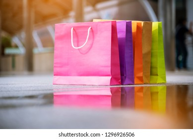 Shopping bags of women crazy shopaholic person at shopping mall indoor. Fashionable Woman love online website with sales tag on black friday. E-commerce digital marketing lifestyle Concept