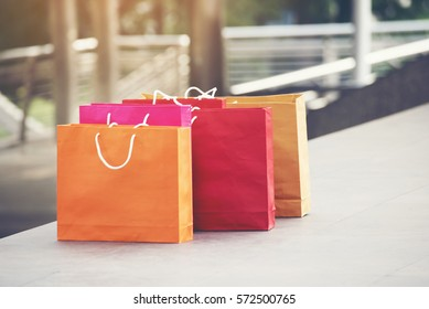 Shopping bags of women crazy shopaholic person at shopping mall indoor. Fashionable Woman love online shopping website with sales tag. E-commerce digital marketing lifestyle Concept
