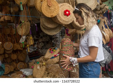 Shopping in Bali. Handmade craft souvenirs, clothes and bags. Shopping, fashion and people concept