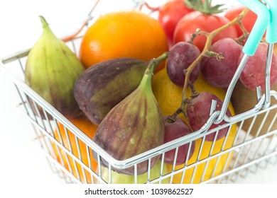 Shopping basked with fruits and vegetables on a white backgrounds / concept healthy, nutrition supporting the diet