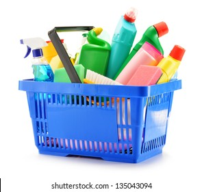 Shopping basket with detergent bottles and chemical cleaning supplies isolated on white