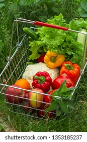Shopping basket with fresh  vegetables and fruit outdoors