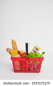 shopping basket full of healthy food over white background with copy space - Shutterstock ID 1937672179