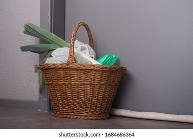 Shopping basket with goods and food  hanging at the front door to confined people at home, neighborhood help concept at quarantine time during the coronavirus pandemic