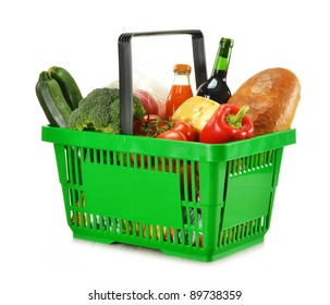 Shopping basket and groceries isolated on white