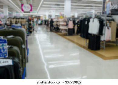 Shopping blur in the super market.The corridor filled with fruits, vegetables and other products, clothing, accessories. And products on the shelves in supermarkets.