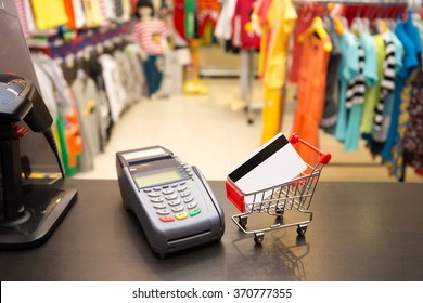 Shopping Card With Credit Card Machine In The Store