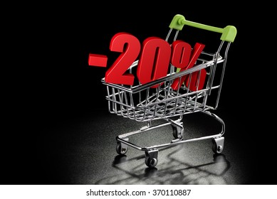 Shopping cart with 20 % percentage rate on a black textured background with copy-space