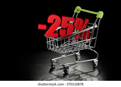 Shopping cart with 25 % percentage rate on a black textured background with copy-space