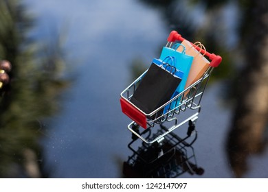 Shopping cart, and shopping bags isolated on white background using as background. Black Friday, boxing day, mid year sales,and year end sales.