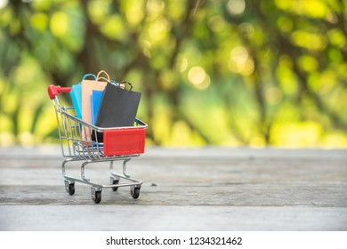 Shopping cart, and shopping bags using as background. Black Friday, boxing day, mid year sales,and year end sales.