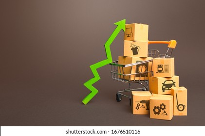 Shopping cart with boxes and green up arrow. Growth trade production, increased sales rate. Improving consumer sentiment. High demand for goods, retail merchandise. Excitement agiotage, rising prices.