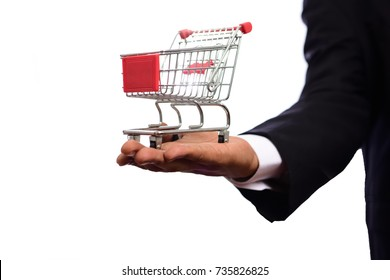 Shopping cart and businessman on white background